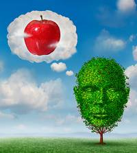Baum-Menschkopf-Zeichnung mit Denkblase mit Apfel